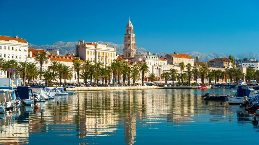 Split is a town on Croatia's Dalmatian Coast, is known for its beaches and the fortresslike complex at its center, Diocletian's Palace, erected by the Roman emperor in the 4th century. In this picture, the Bell Tower and Green Market were reflected in the water. Tourists wandering around the colorful Green Market, which brims with stalls selling everything from fruits to flowers and local products.