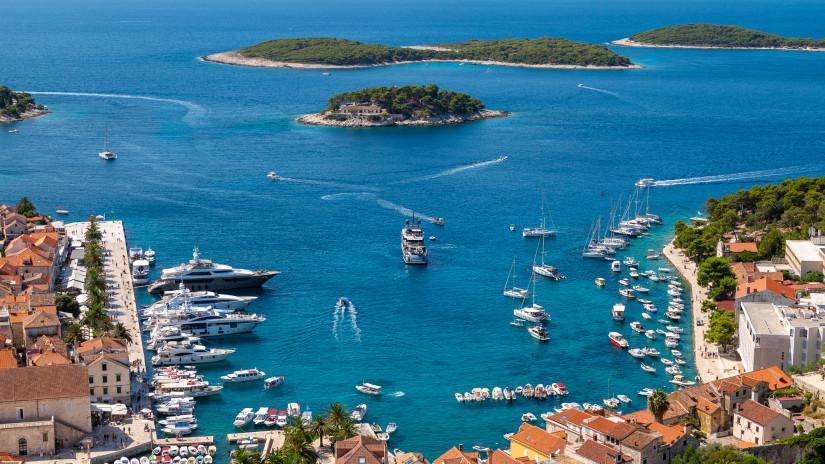 Aerial view of amazing coastal town Hvar in Croatia, popular mediterranean tourist resort in summertime, Europe.
