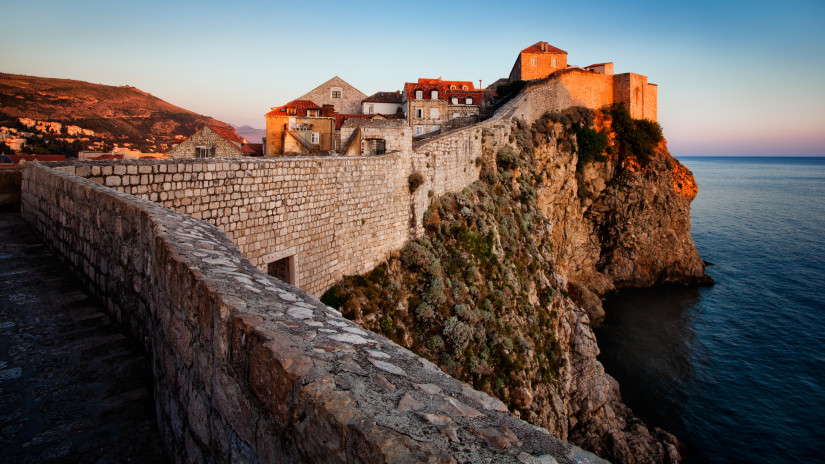 The old town of Dubrovnik is surrounded by old, solid walls, protecting citizens of old and attracting tourists in more modern times.