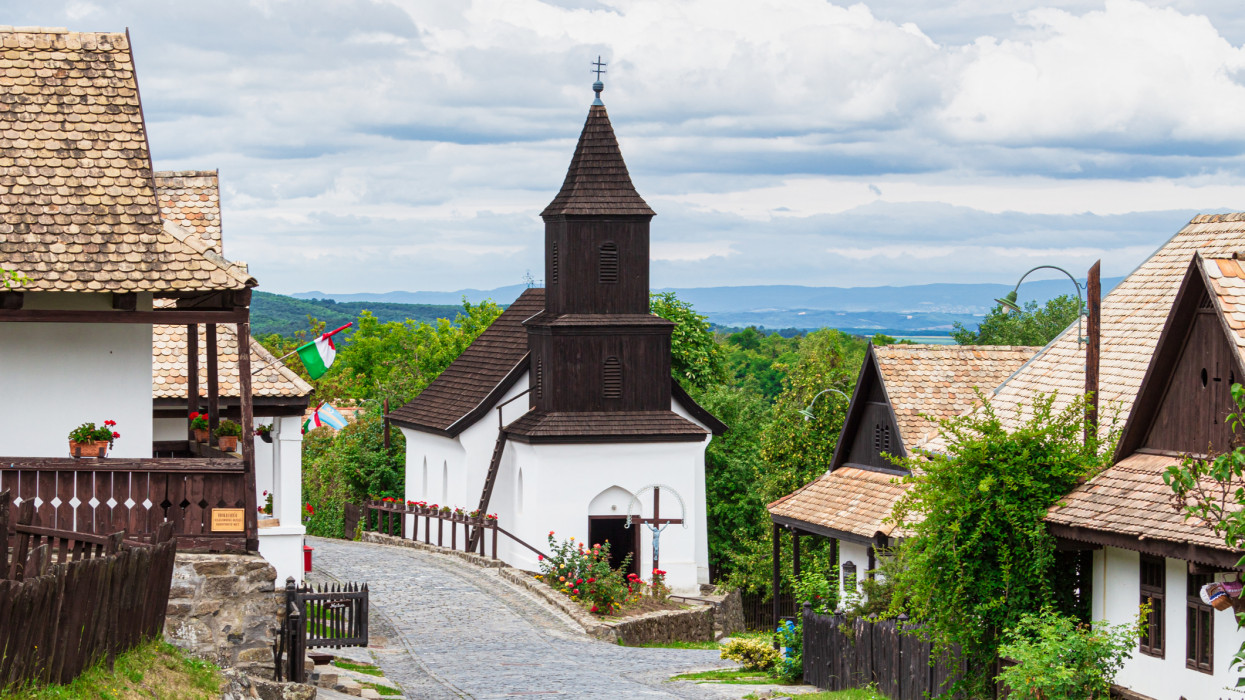 A beautiful street picture in Hollókő (Holloko) with a church and houses