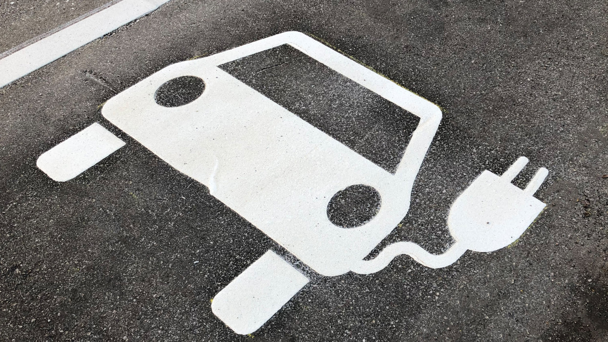 freshly made sign for parking spots for electric cars