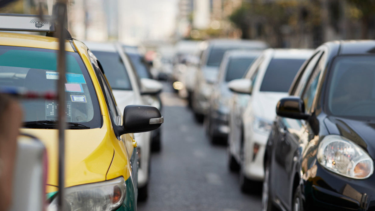 Cars on road in traffic jam during rush hour at city