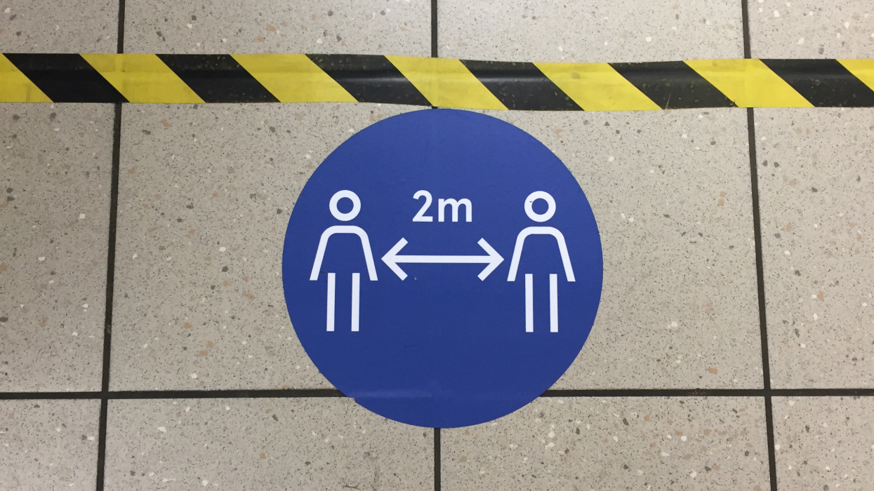 social distancing, London, UK - 4/3/2020: social distancing for Coronavirus covid-19 in tesco supermarket Tottenham London to government guidelines for distance to avoid spread of virus pathogen