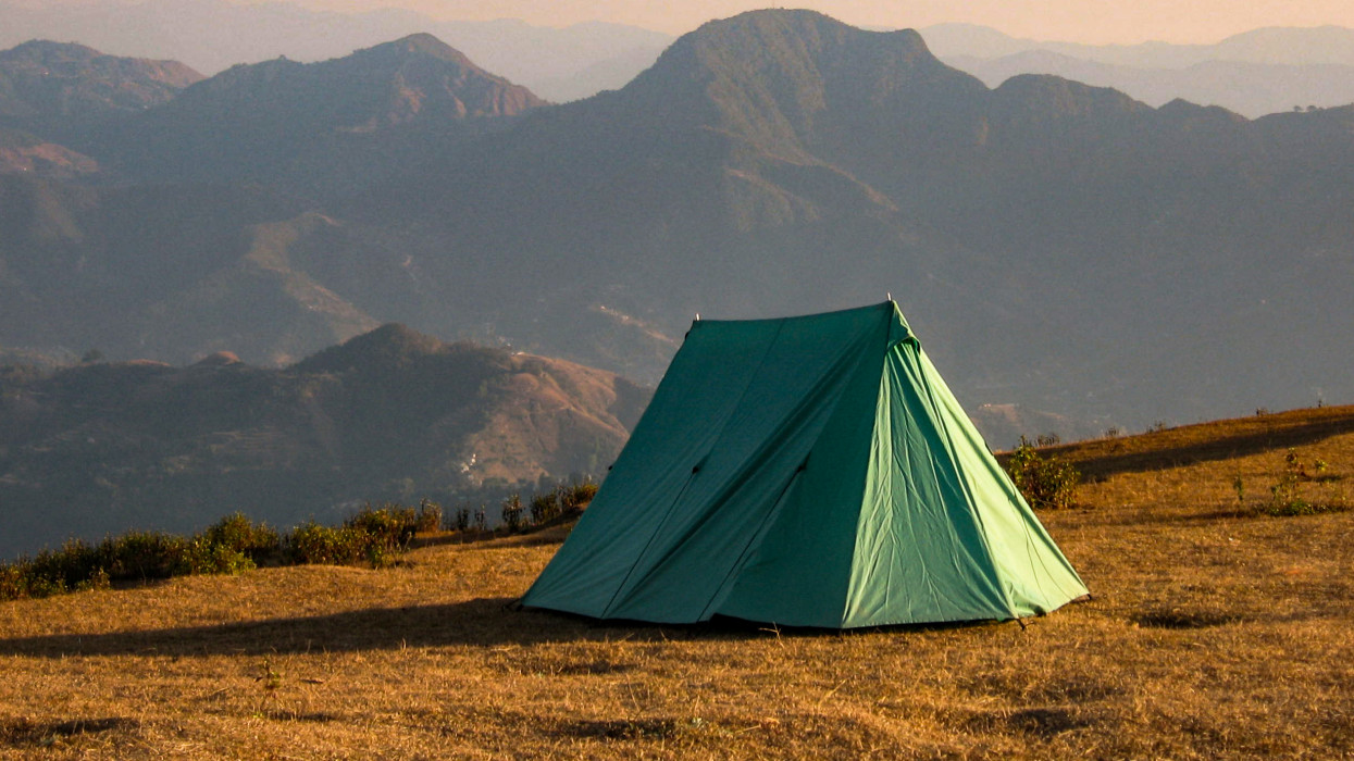 Camping above the hills in the the with the aerial view. Sirkot, Sworek, Syangja, Nepal. Amazing paragliding spot.