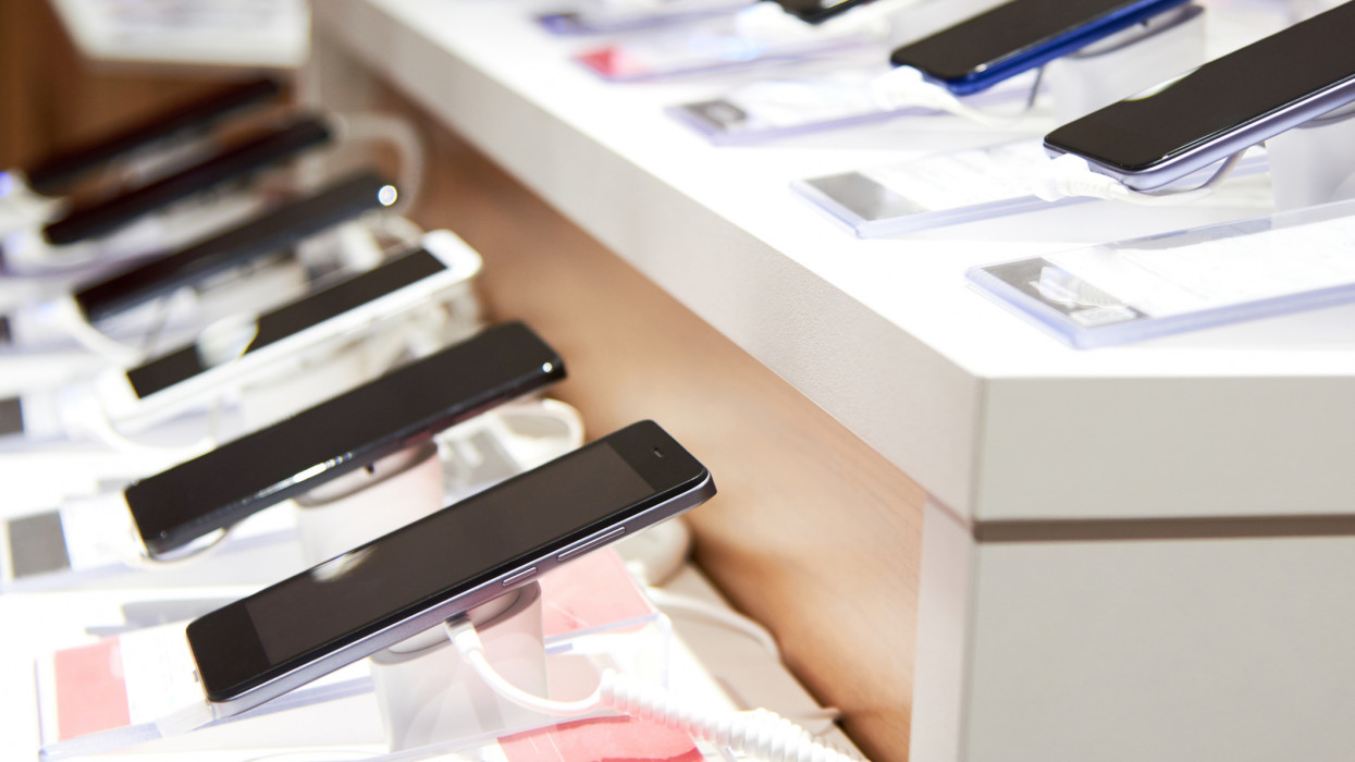 Smartphones on the counter of a modern electronics store