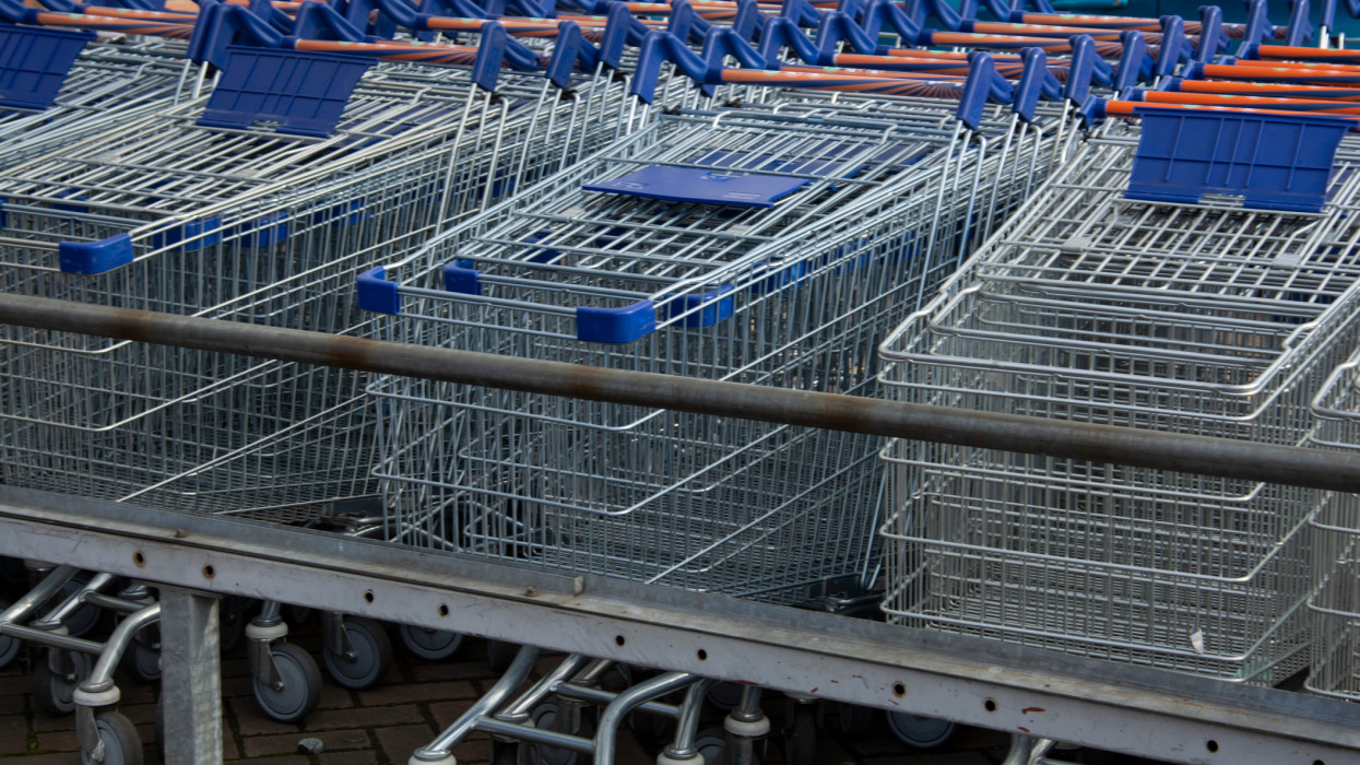 Corby, U.K, 19 March 2019 - A long row of shopping trolleys carts at Asda Shop, outside of a large supermarket. Shopping.
