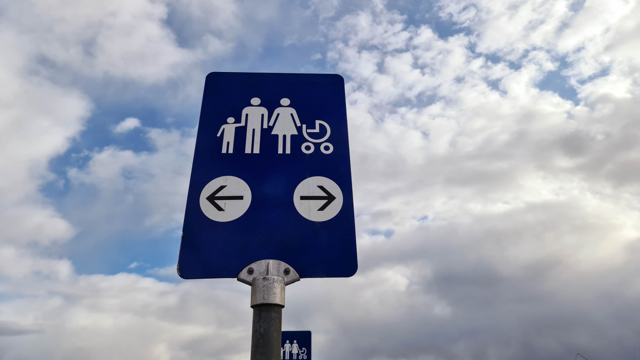 Close up view of IKEA blue sign for family car parking on white clouds background. Europe. Sweden. Uppsala.