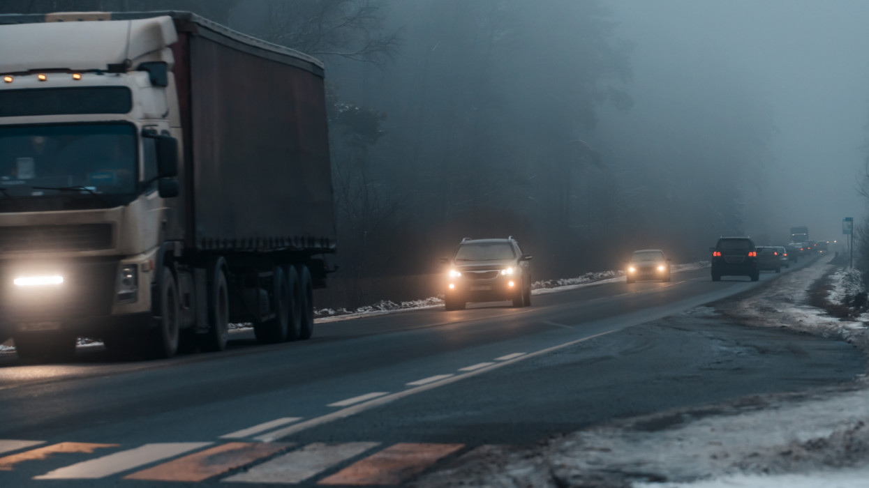Cars in the fog on road