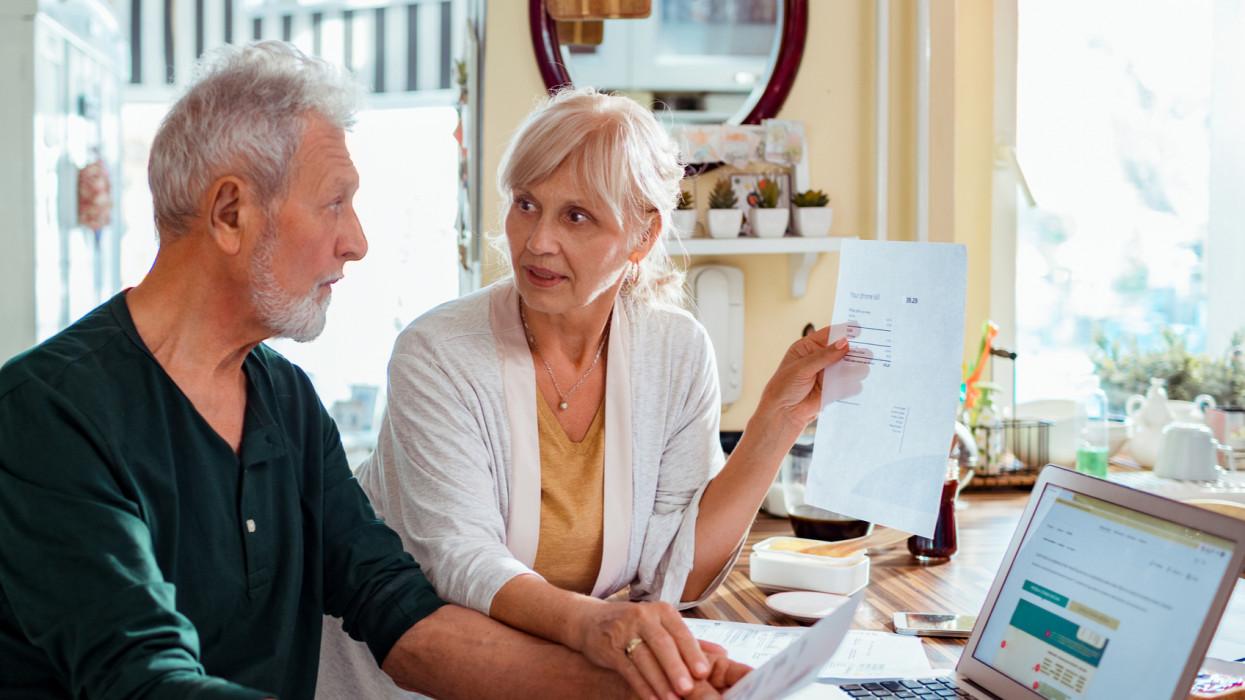Close up of a senior couple doing home finances