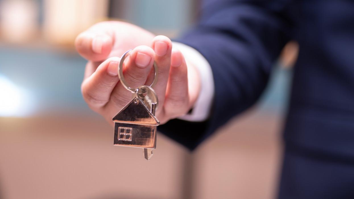 Home concept,Businessmen holding home keys