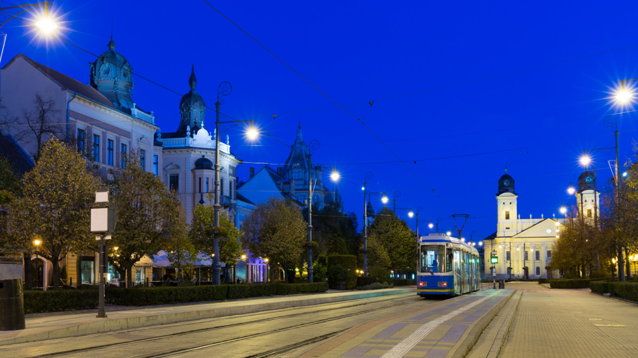 Nightlife of illuminated central Debrecen streets with Great Protestant Church, Hungary