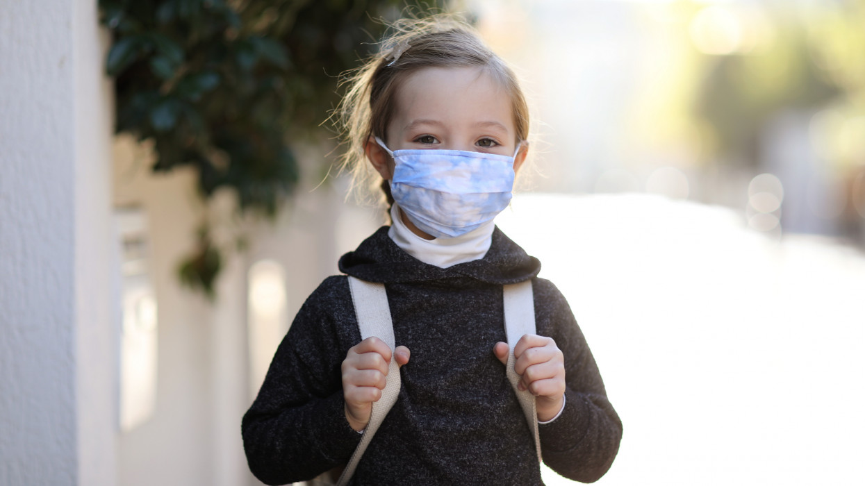 Child with protective face mask during COVID-19 pandemic