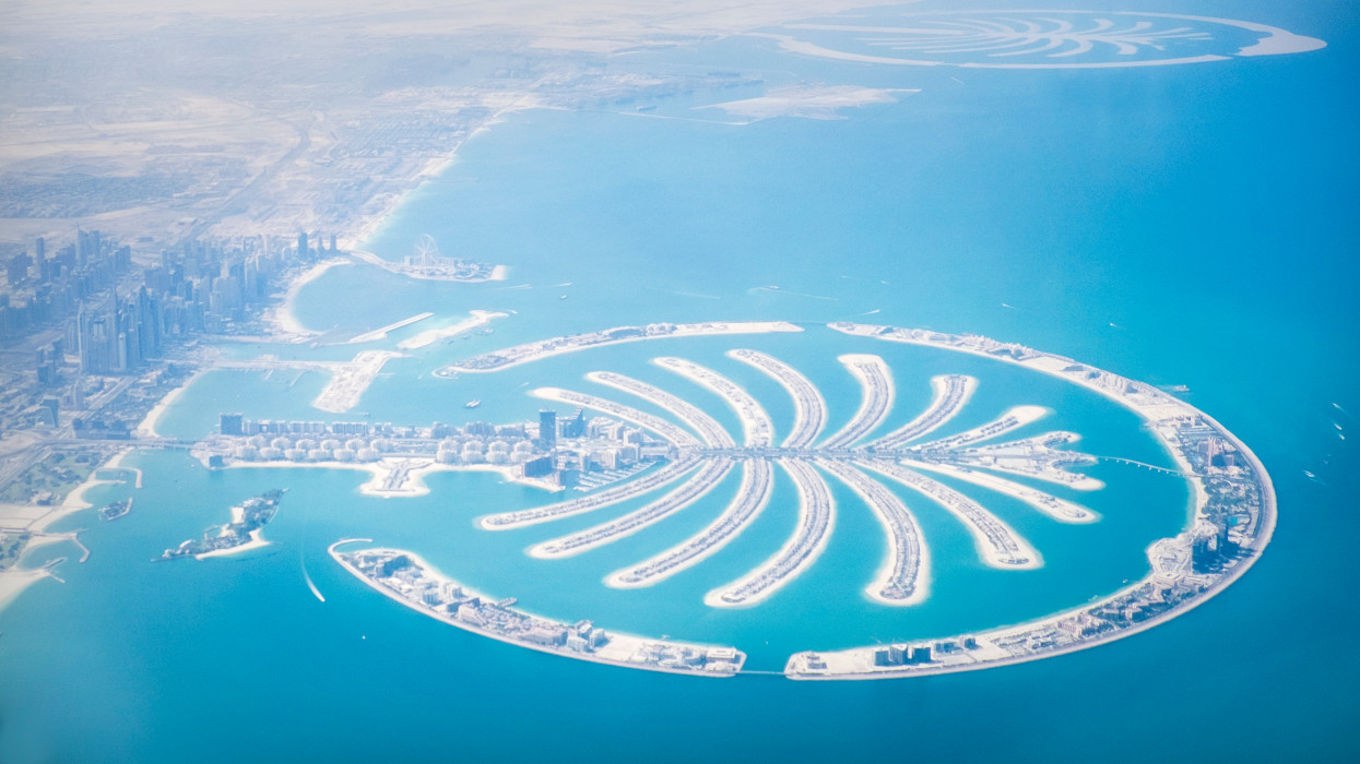 Aerial view of the exclusive island of luxury hotels and residences of The Palm Jumeirah in Dubai, United Arab Emirates.
