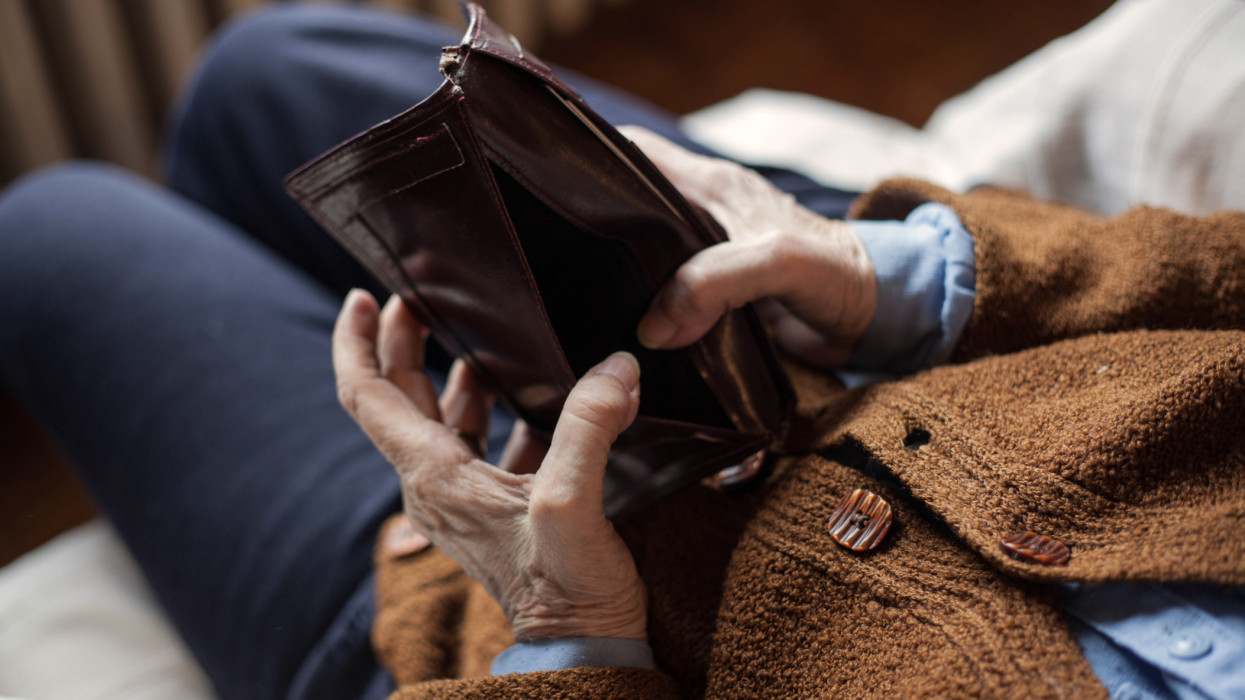 Old empty wallet in the hands .Vintage empty purse in hands of women . Poverty concept.