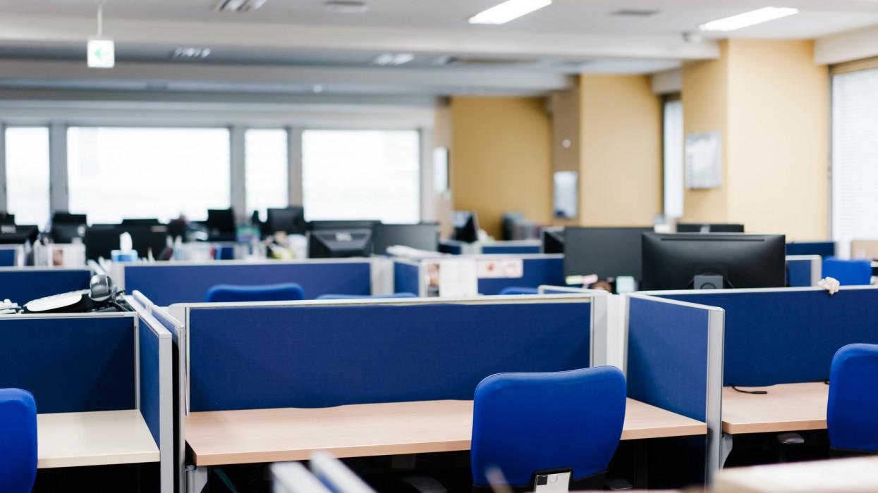 An empty desk in an unattended office.