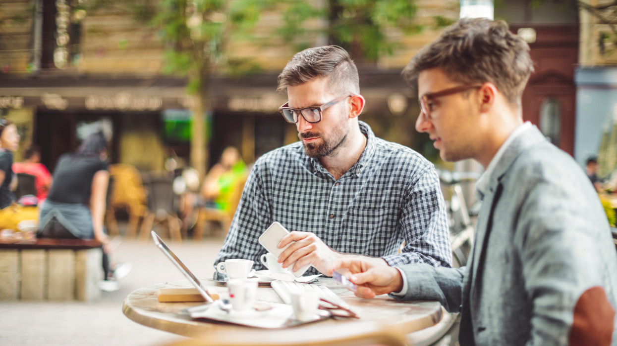 Young businessmen are having a coffee break