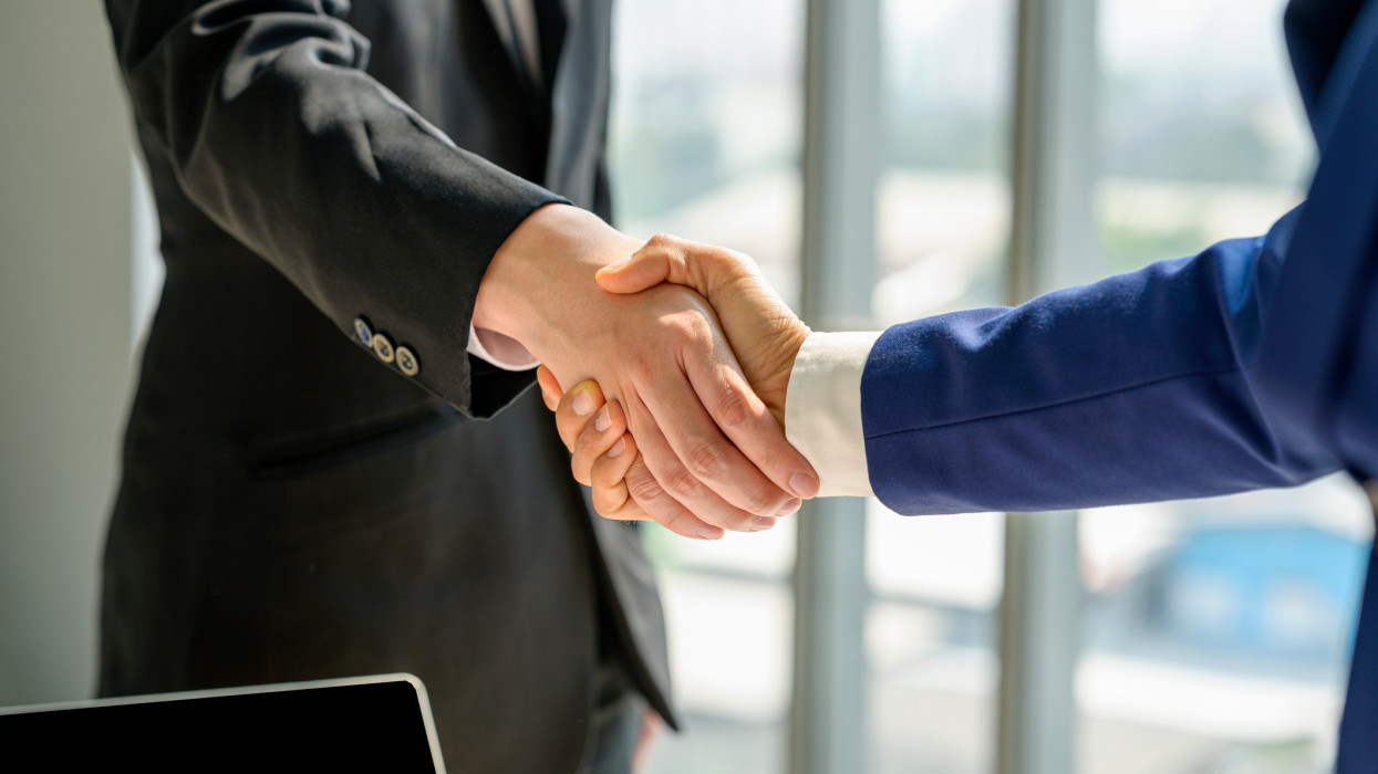 Close-up of Business handshake deal success concept.