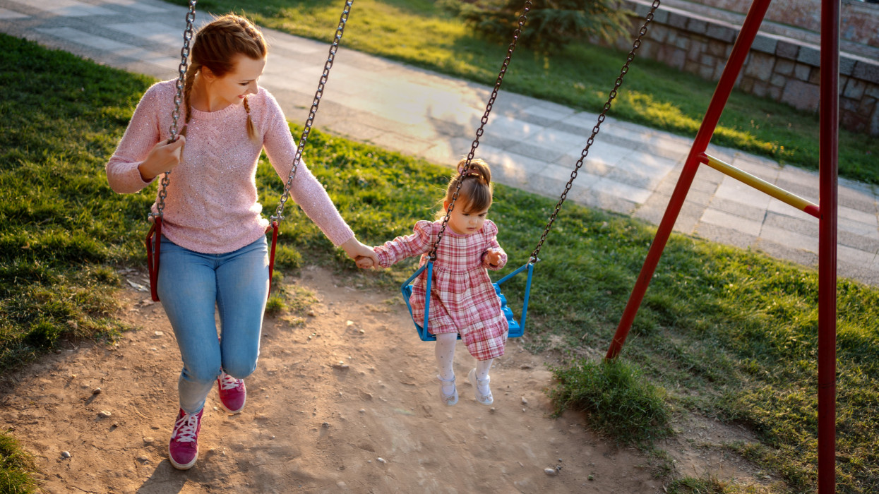Single mother playing with her daughter in the park