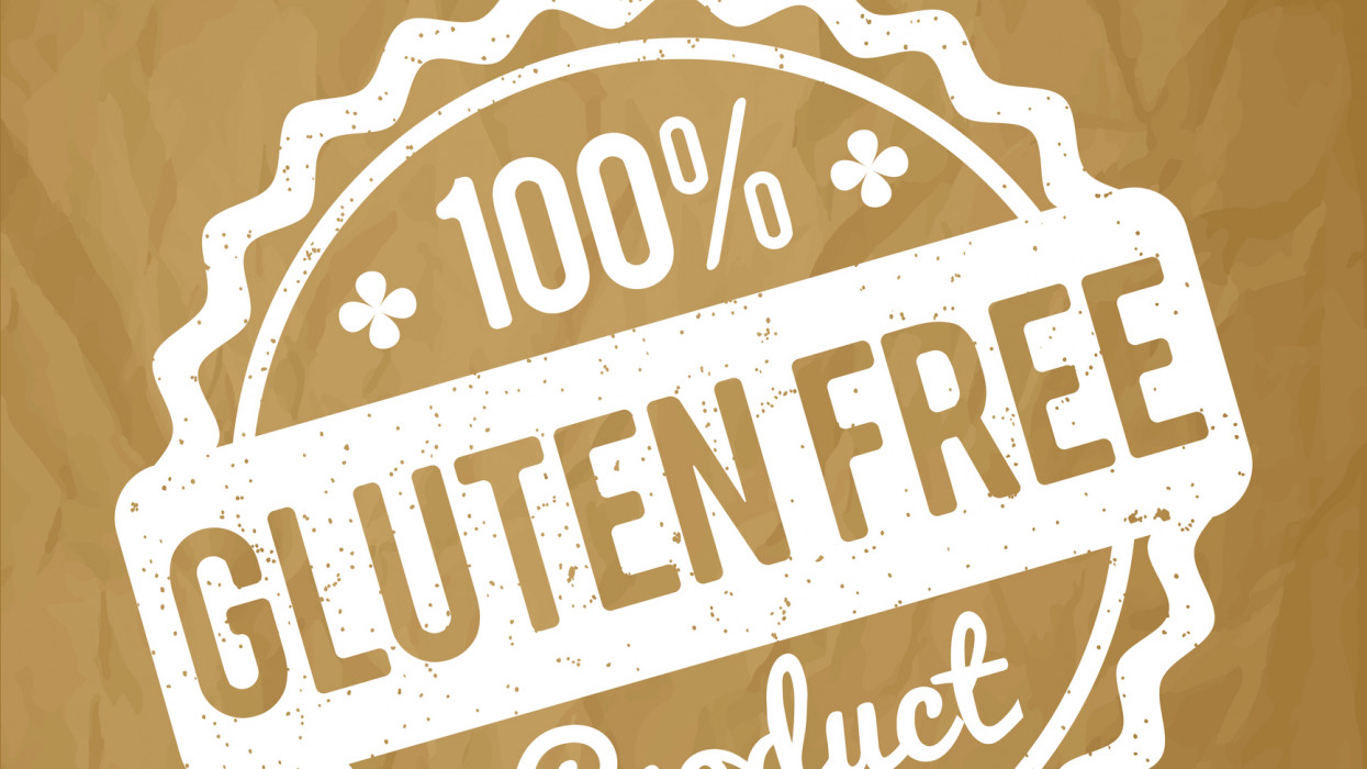 Gluten FREE Product rubber stamp white on a crumpled paper brown background.