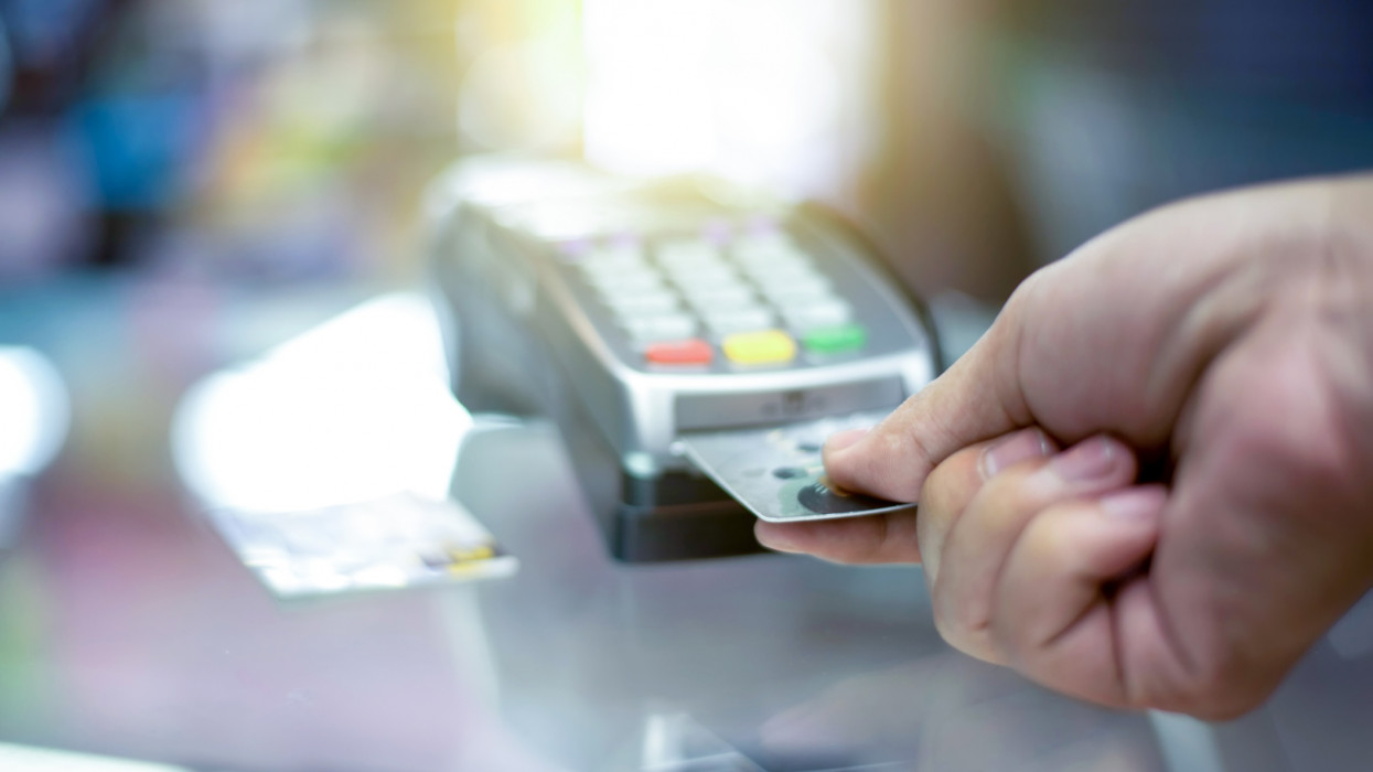 a finger press on credit card