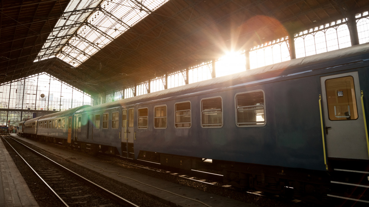 Picture of an incoming train at Nyugati train station, Budapest, Hungary, during a summer sunset