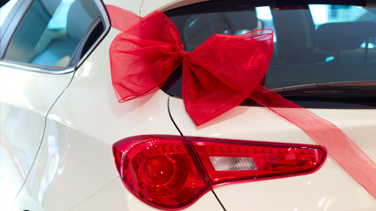 New car with red ribbon and red bow