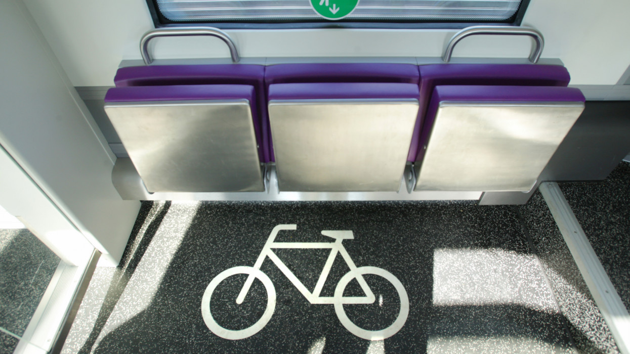 Place to transport bicycle and green sticker for people make social distance at the train amid the Coronavirus Pandemic.