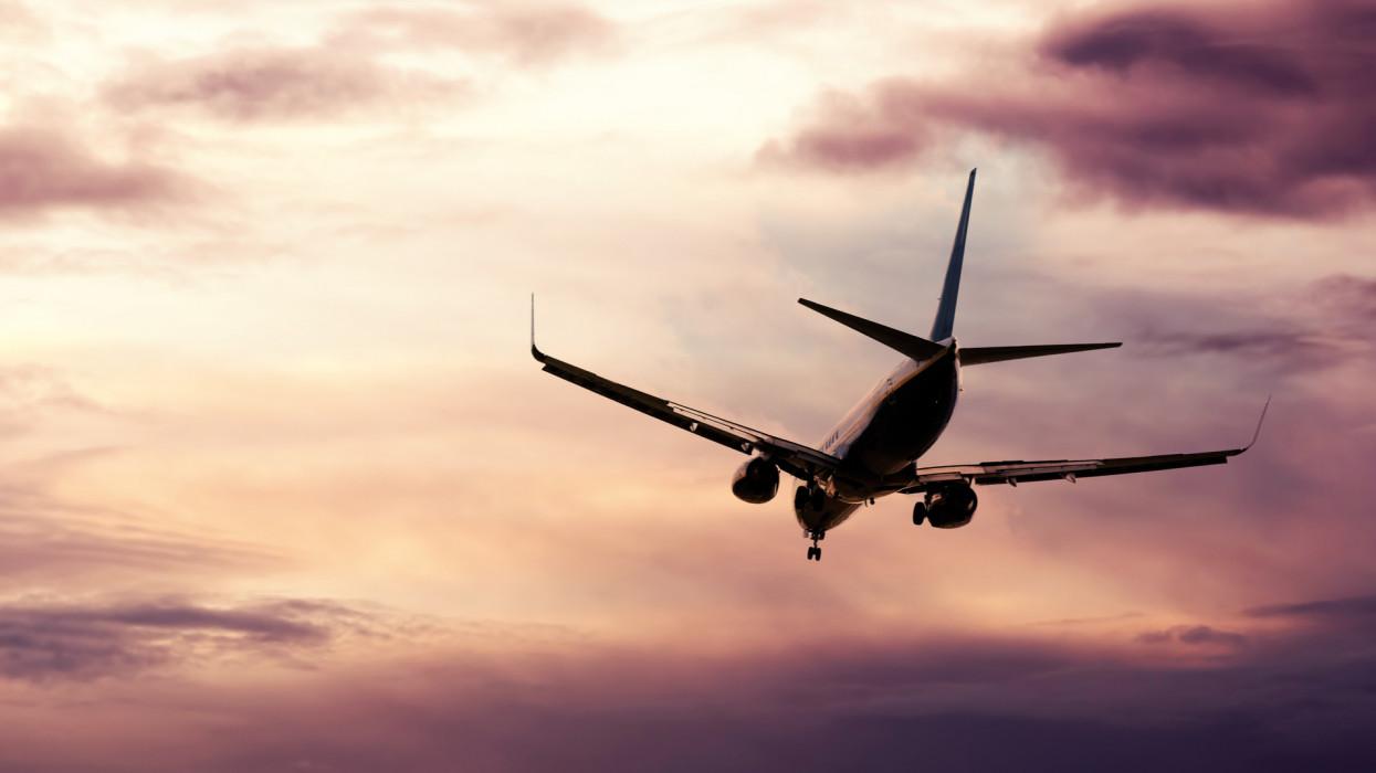 Passenger jet descending in evening sky