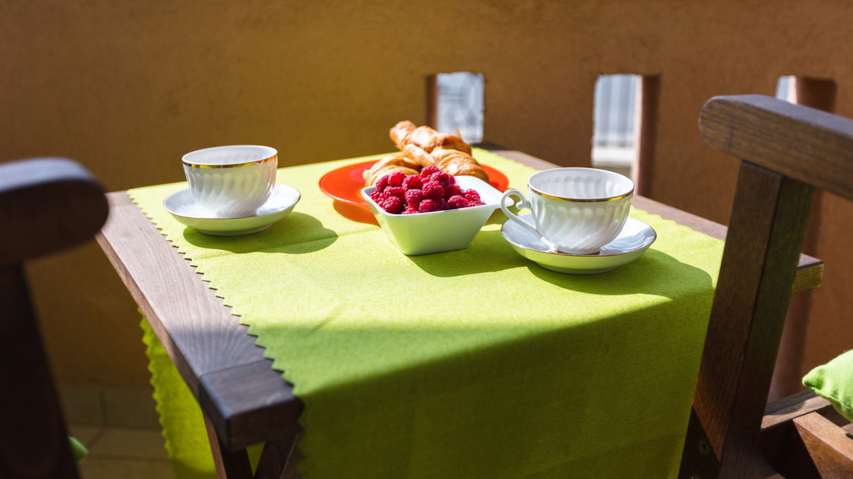 Croissants and raspberries on a table