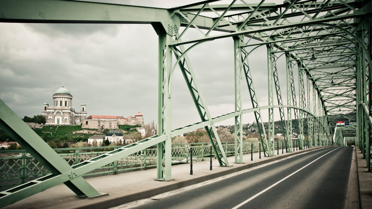 Photograph of the Mária Valéria bridge, which is connecting Esztergom (in Hungary) with the city of Sturovo in Slovakia. The famous bridge is made of steel. It was rebuilt in 2001 with the support of the European Union. It is called in Hungarian Mária Valéria híd and in Slovak language most Márie Valérie.In the background, on the Hungarian side of the Danube river is the famous cathedral : Esztergom Basilica. It is the largest church in Hungary.Esztergom was the capital of Hungary from the 10th till the 13th century.This photograph was taken in spring 2011 during a journey by bicycle across Europe, Middle-East and Asia.
