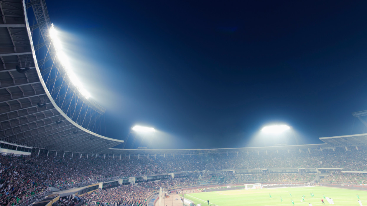 Sports stadium arena game light up by lights at night