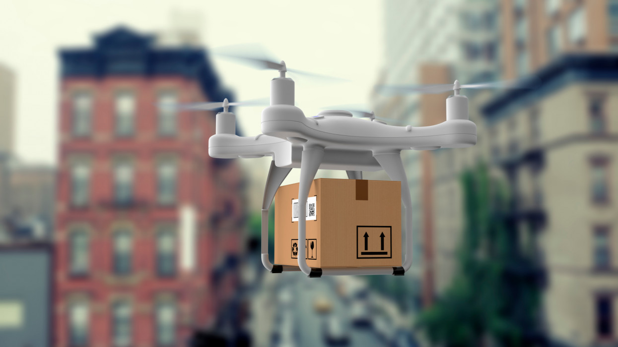 Delivery drone flying in city
