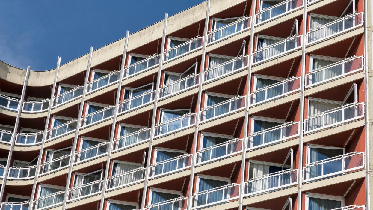 Modern hotel facade balconies closeup