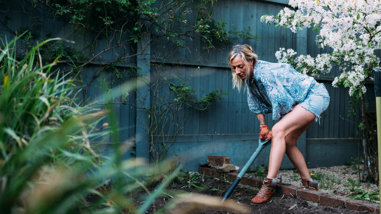 Blonde female adult gardening at home