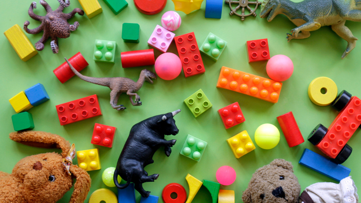 High Angle View Of Toys Over Green Background