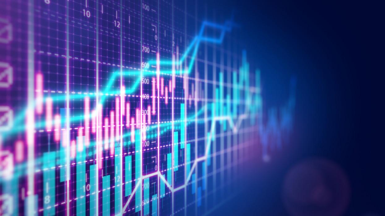 Stock market financial growth chart on dark background.