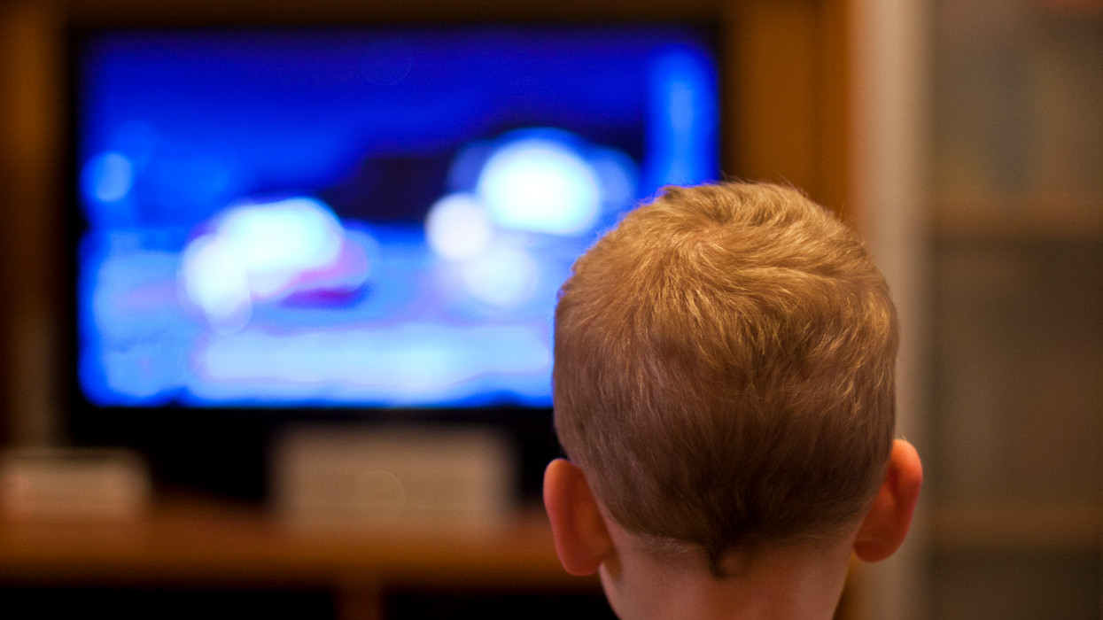 Rare view of boy watching television.