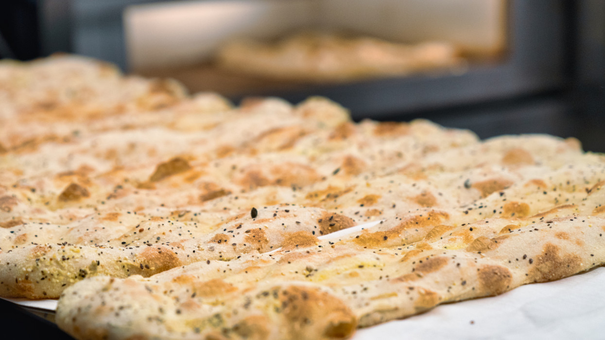 Focaccia is a type of flat bread  made with flour, salt, yeast and olive oil.