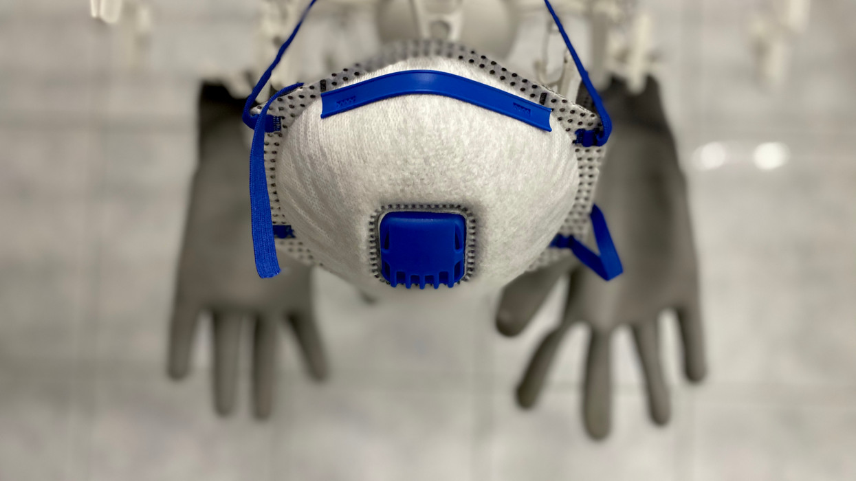 hanging gloves and face mask