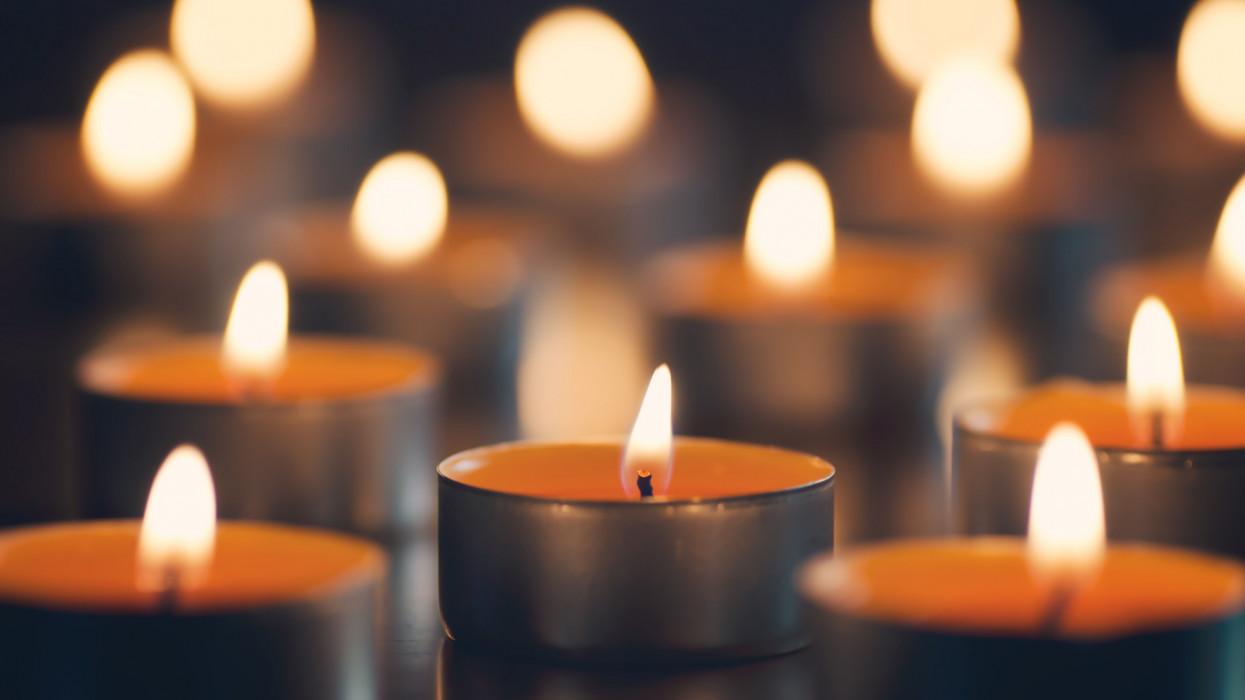 Small orange candles lit