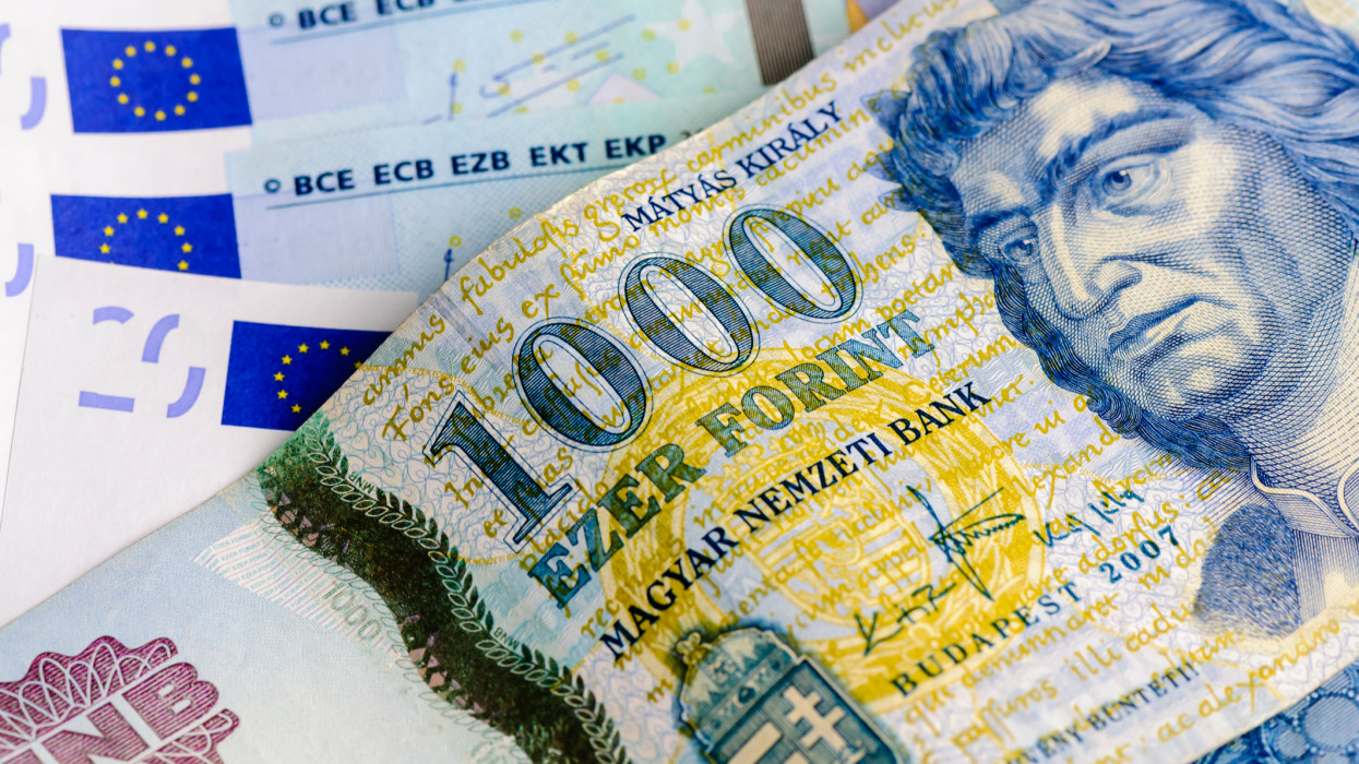 1000 Ezer Forint Hungarian bank note against a number of Euro notes