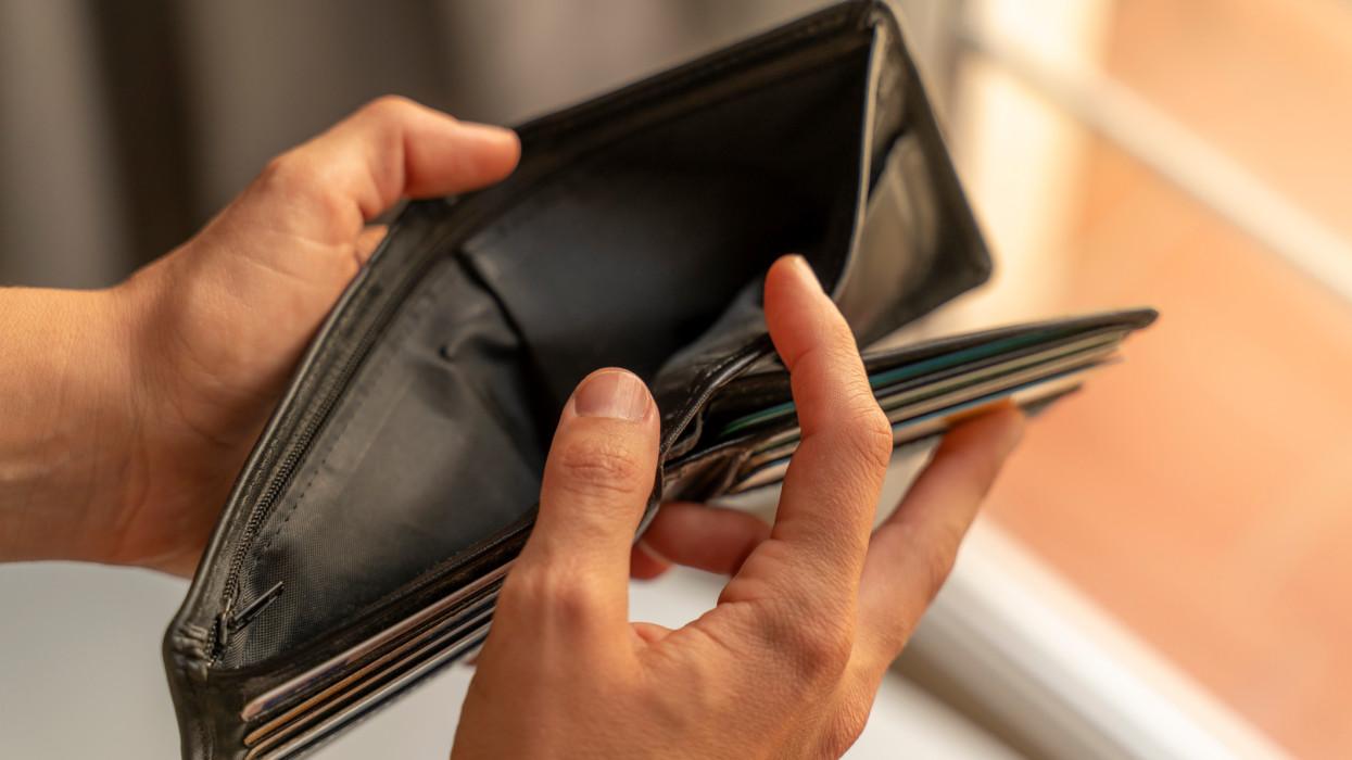 Woman hands opening an empty wallet