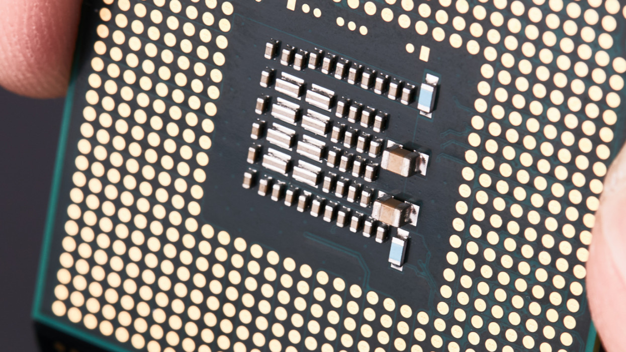 CPU. Production of microchips and processors for electronics. On a dark background. computer industry concept