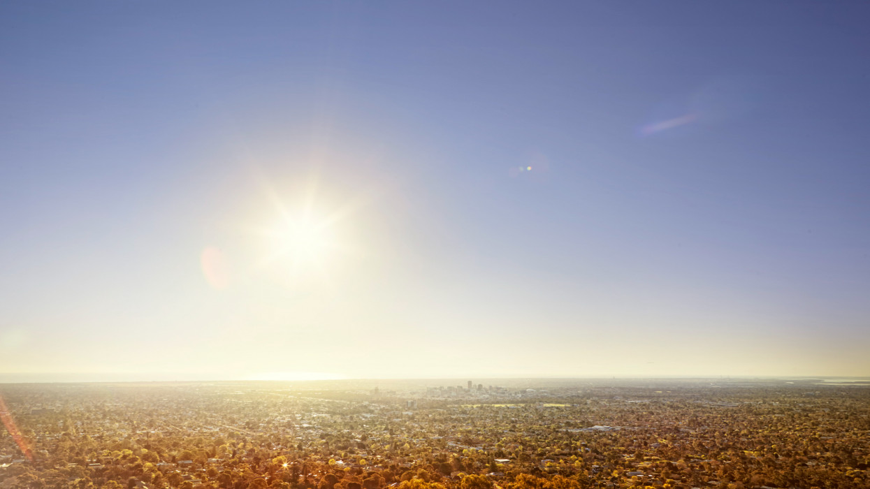 the sun shining above the city of Adelaide, Australia.