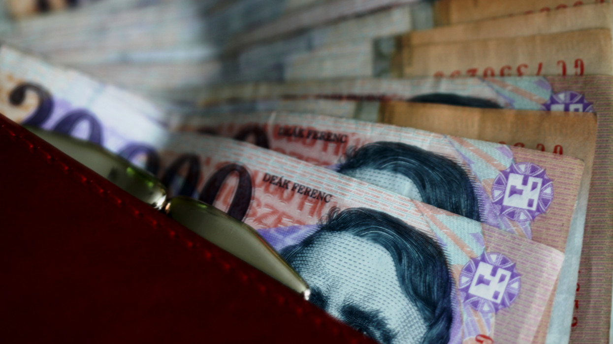 Rep purse filled with Hungarian Forint.