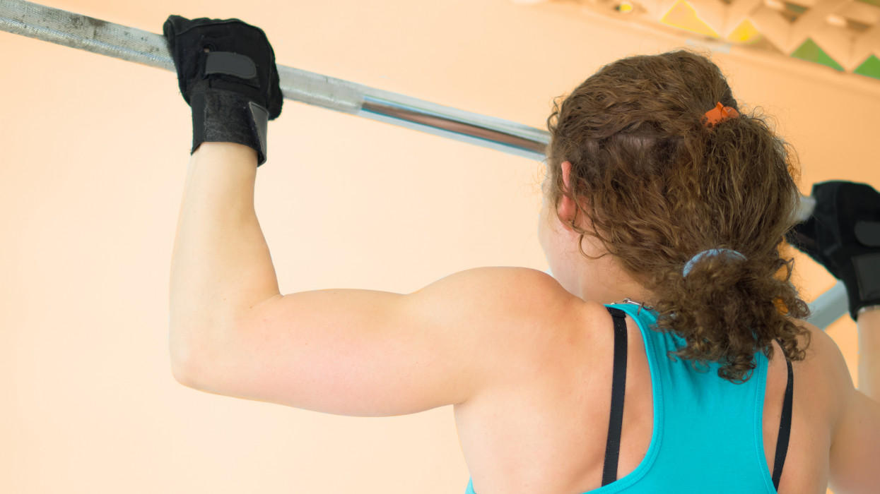 Young woman under training in Gym