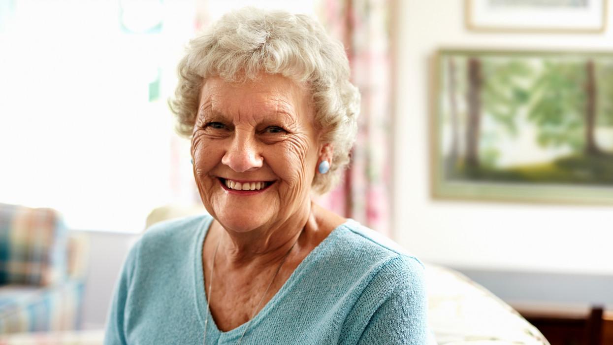 Portrait of happy senior woman in nursing home