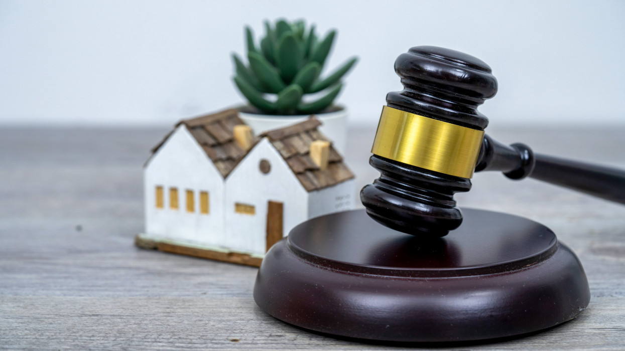 House with gavel. Real estate law and house auction concept.