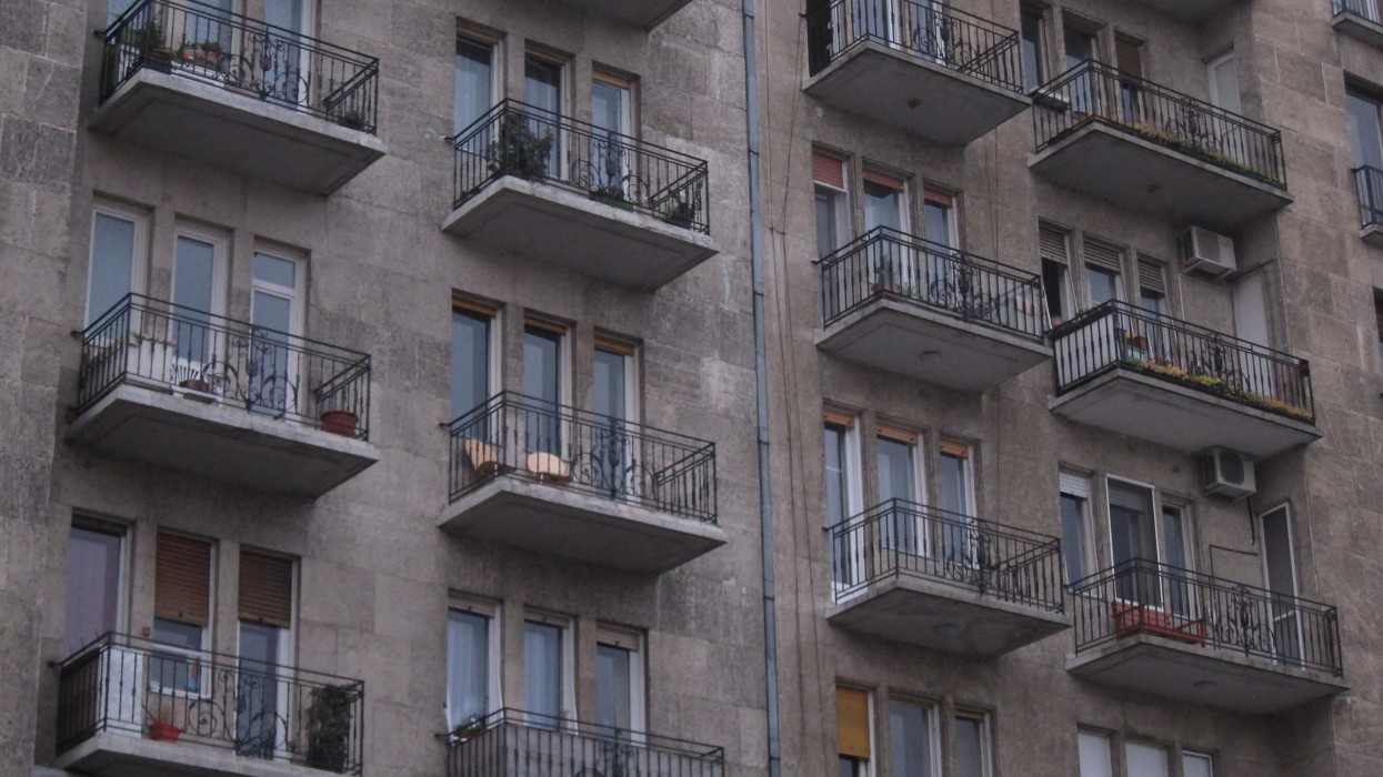 Old building facade with balconies on each unit.