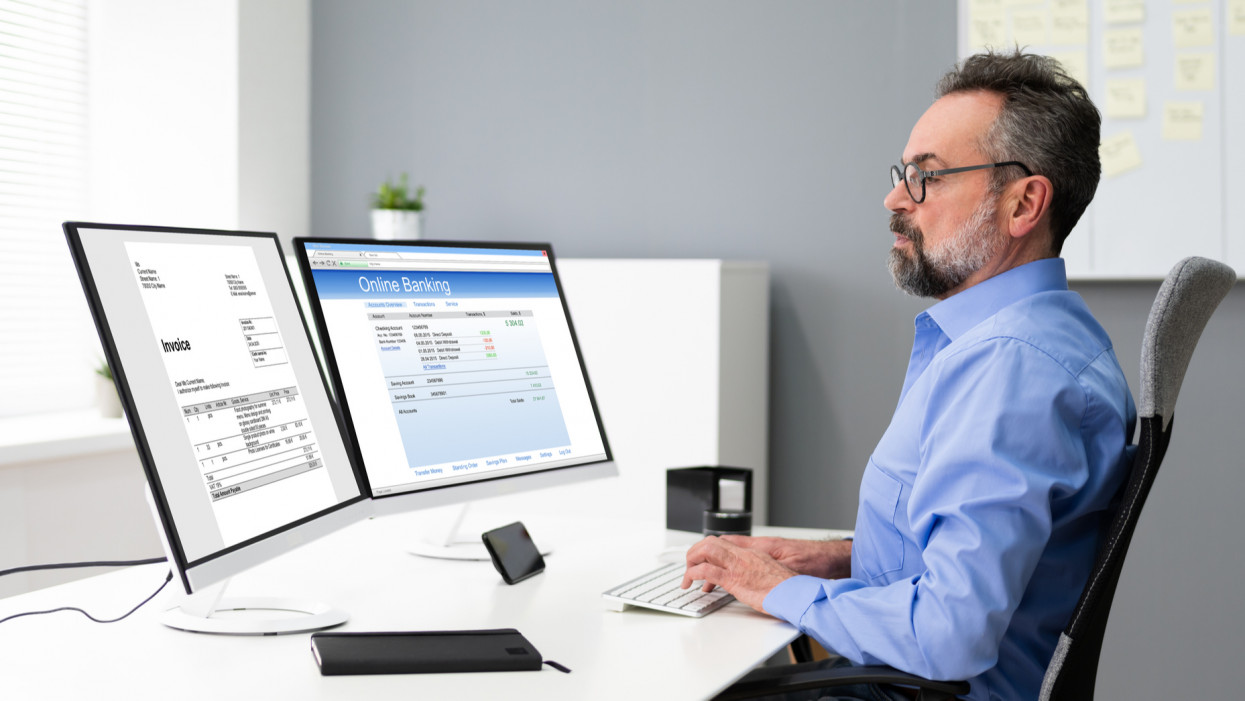 Electronic Invoice Bill Online. Tax Manager At Desk